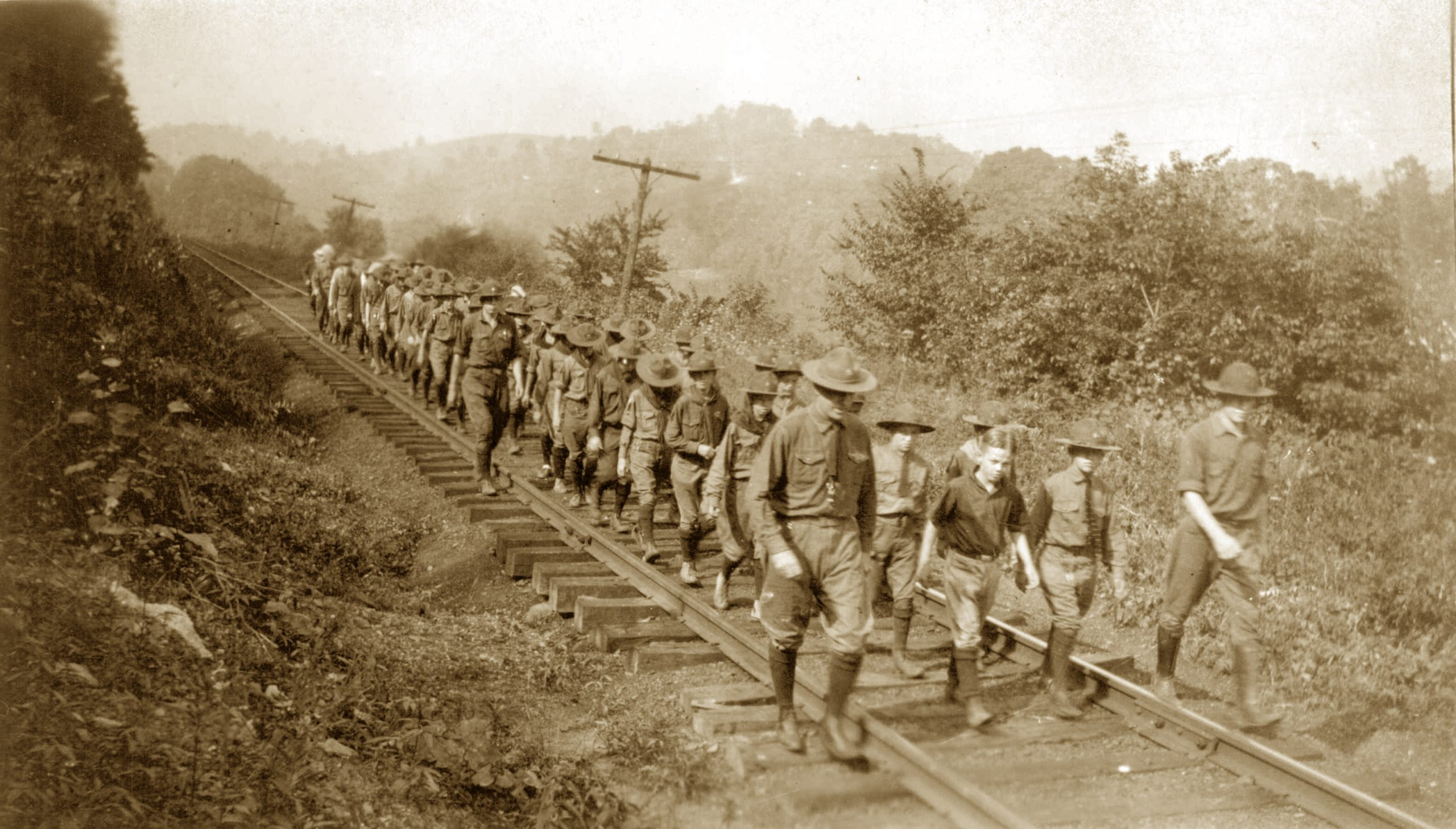 Scouts hike along the railroad tracks in 1921