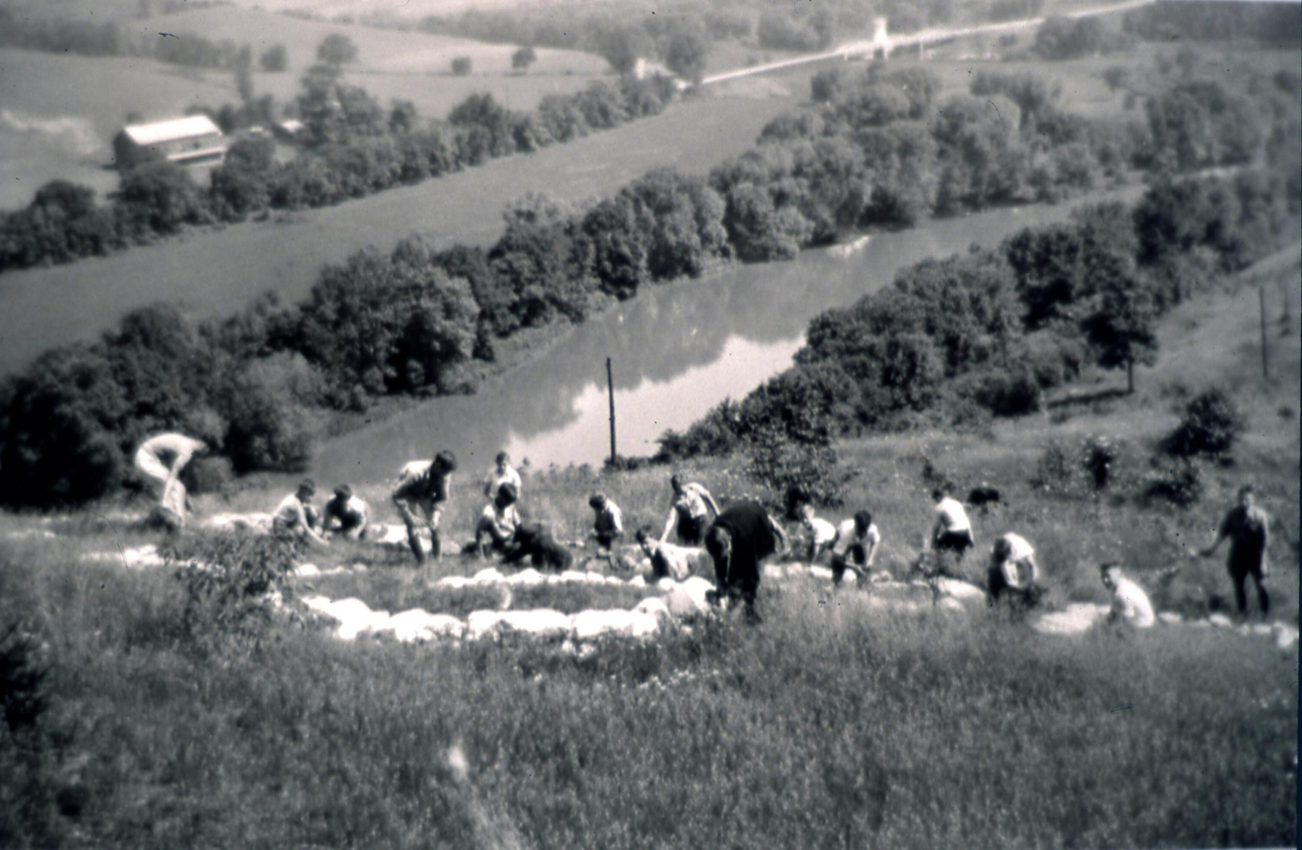 Scouts laying rocks in 1930